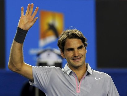 Roger Federer of Switzerland celebrates defeating Nikolay Davydenko of Russia in their men's singles match at the Australian Open tennis tou
