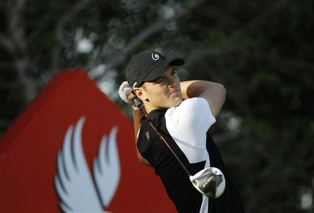 Martin Kaymer of Germany tees off on the 13th hole during the first round of the Abu Dhabi Golf Championship at the Abu Dhabi Golf Club Janu