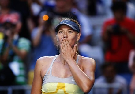 Maria Sharapova of Russia blows kisses to the crowd after defeating Misaki Doi of Japan during their women's singles match at the Australian