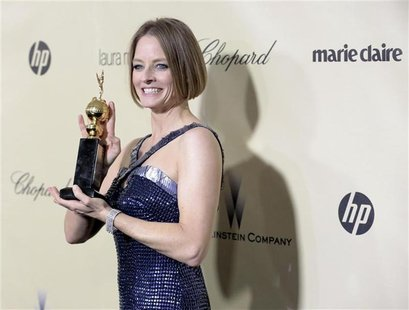 Actress Jodie Foster poses with her Cecil B. DeMille award at the Weinstein Company after party following the 70th annual Golden Globe Award