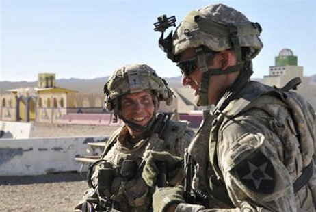 Staff Sgt. Robert Bales (L) is seen during a training exercise at Fort Irwin, California, in this August 23, 2011 DVIDS handout photo. REUTE