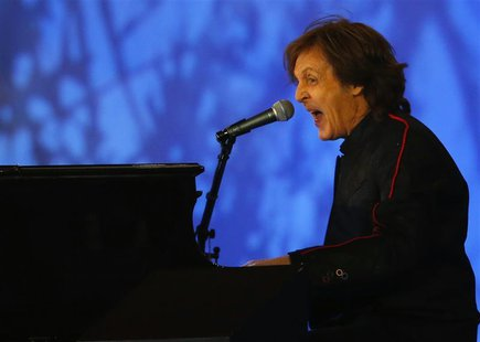 Musician Paul McCartney performs during the opening ceremony of the London 2012 Olympic Games at the Olympic Stadium July 27, 2012. REUTERS/