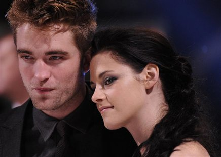 Actors Robert Pattinson (L) and Kristen Stewart arrive for the British premiere of 'The Twilight Saga: Breaking Dawn' at Westfield Stratford