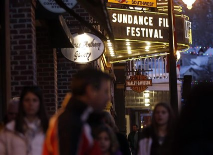 People walk past the Egyptian Theatre along Main Street before the opening day of the Sundance Film Festival in Park City, Utah, January 16,