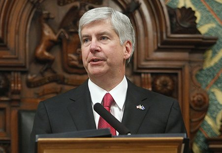 Gov. Snyder stands at the Rostrum of a joint session of the State Legislature to deliver his State of the State address.