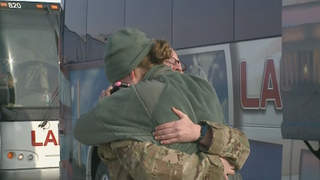 A soldier from the 1157th receives a hug shortly after arriving at the Outagamie County Regional Airport in Greenville, Friday, January 18, 2013. (courtesy of FOX 11).