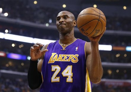 Los Angeles Lakers' Kobe Bryant reacts after being called for a foul during the first half of the Lakers' loss to the Los Angeles Clippers i