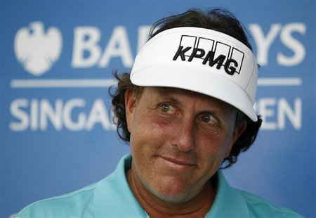 Phil Mickelson of the U.S. smiles during a news conference ahead of the Barclays Singapore Open golf tournament in Singapore November 7, 201