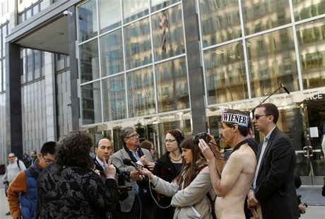 Nudists gathered prior to a hearing on a lawsuit seeking to block implementation of San Francisco's ban on public nudity. REUTERS/Robert Gal