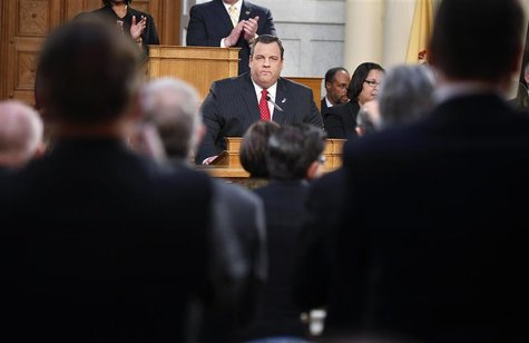 New Jersey Governor Chris Christie receives a standing ovation as he gives his State of the State address in the assembly chamber in Trenton