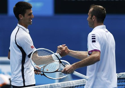 Novak Djokovic of Serbia (L) shakes hands with Radek Stepanek of Czech Republic after defeating him in their men's singles match at the Aust
