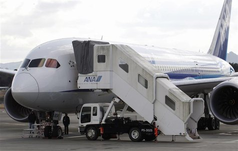 U.S. Federal Aviation Administration (FAA) technical advisor Eric West (L) inspects All Nippon Airways' (ANA) Boeing Co 787 Dreamliner plane