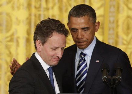 U.S. President Barack Obama (R) stands next to outgoing U.S. Secretary of Treasury Timothy Geithner in the East Room of the White House in W