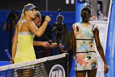 Maria Sharapova of Russia (L) celebrates defeating Venus Williams of the U.S. (R) in their women's singles match at the Australian Open tenn