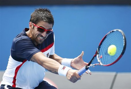 Janko Tipsarevic of Serbia hits a return to Julien Benneteau of France during their men's singles match at the Australian Open tennis tourna