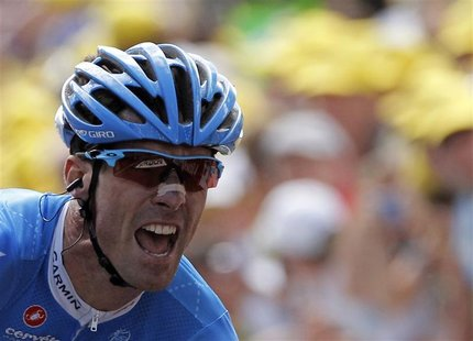 Garmin-Sharp rider David Millar of Britain reacts on the finish line as he wins the 12th stage of the 99th Tour de France cycling race betwe