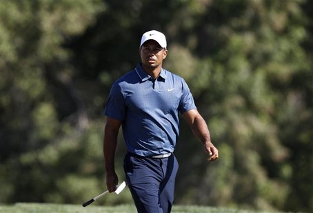 Tiger Woods of the U.S. walks at the seventh green during the second round of the Abu Dhabi Golf Championship at the Abu Dhabi Golf Club Jan