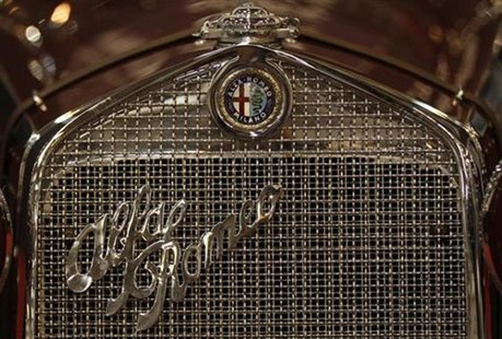 The emblem of an Alfa Romeo is pictured during a press presentation prior to the Essen Motor Show in Essen November 30, 2012. REUTERS/Ina Fa