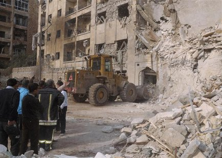 Rubble is removed from the entrance of a damaged building after a large blast hit a neighbourhood of the Syrian city of Aleppo January 18, 2