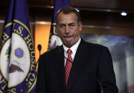 "U.S. House Speaker John Boehner (R-OH) arrives to speak to the media on the ""fiscal cliff"" on Capitol Hill in Washington, December 21, 2012."