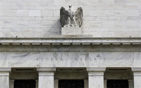 A view shows an eagle sculpture on Federal Reserve building, on the day it will release minutes of Federal Open Market Committee from August