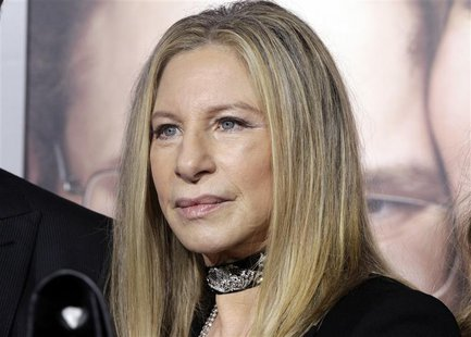 "Barbra Streisand, star of the new film ""The Guilt Trip"" poses on the arrivals line at the film's premiere in Los Angeles December 11, 2012."