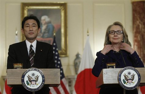 U.S. Secretary of State Hillary Clinton (R) meets Japan's Foreign Minister Fumio Kishida at the State Department in Washington January 18, 2