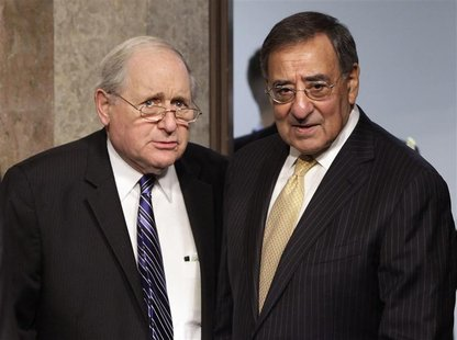 U.S. Secretary of Defense Leon Panetta (R) and Senate Armed Services Committee Chairman Carl Levin (D-MI) arrive at the Senate Armed Service