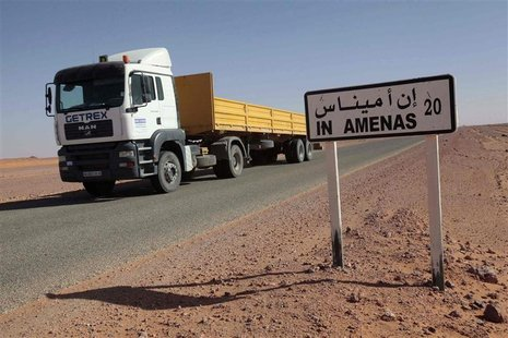 A truck passes by a road sign indicating In Amenas, about 100 km (60 miles) from the Algerian and Libyan border, where Islamist militants we