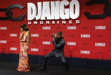 "Cast members Kerry Washington (L) and Jamie Foxx pose on the red carpet for the German premiere of ""Django Unchained"" in Berlin January 8, 2"