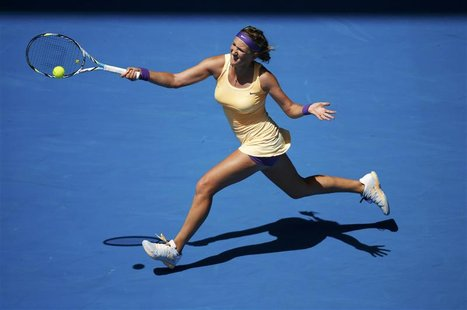 Victoria Azarenka of Belarus hits a return to Jamie Hampton of the U.S. during their women's singles match at the Australian Open tennis tou