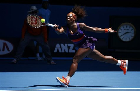 Serena Williams of the U.S. hits a return to Ayumi Morita of Japan during their women's singles match at the Australian Open tennis tourname