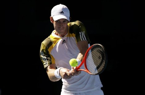 Andy Murray of Britain hits a return to Ricardas Berankis of Lithuania during their men's singles match at the Australian Open tennis tourna