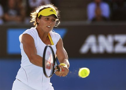 Laura Robson of Britain hits a return to Sloane Stephens of the U.S. during their women's singles match at the Australian Open tennis tourna