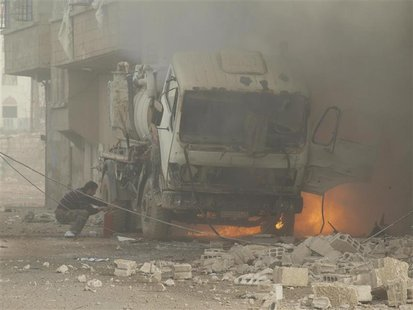A fire burns after what activists said were missiles fired by a Syrian Air Force fighter jet loyal to President Bashar al-Assad in Daraya Ja