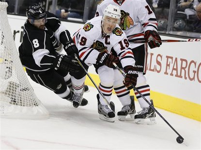 Chicago Blackhawks Jonathan Toews (R) fights for the puck with Los Angeles Kings Drew Doughty during the first period of their NHL hockey ga