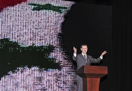 Syria's President Bashar al-Assad speaks at the Opera House in Damascus January 6, 2013, in this handout photograph released by Syria's nati