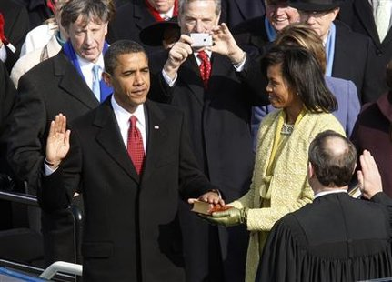 Barack Obama takes the Oath of Office as the 44th president of the United States from U.S. Chief Justice John Roberts as his wife Michelle holds the Bible during the inauguration ceremony in Washington, in this January 20, 2009 file photo.  Credit: Reuters/Jim Bourg/Files