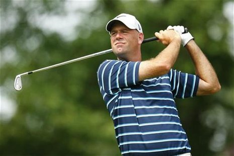 Stewart Cink of the U.S. watches his tee shot on the 13th hole during the second round of the Wells Fargo Championship PGA golf tournament i