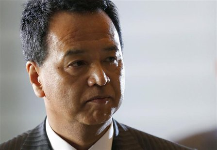 Japan's newly-appointed minister for economic revival Akira Amari arrives at Prime Minister Shinzo Abe's official residence in Tokyo Decembe