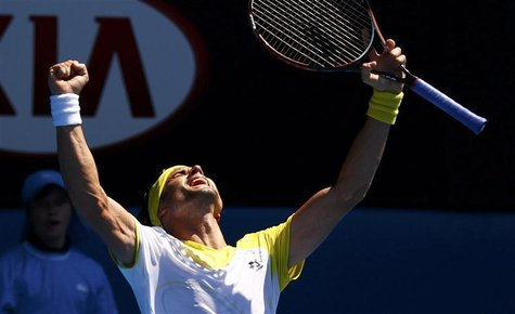 David Ferrer of Spain celebrates defeating Kei Nishikori of Japan in their men's singles match at the Australian Open tennis tournament in M
