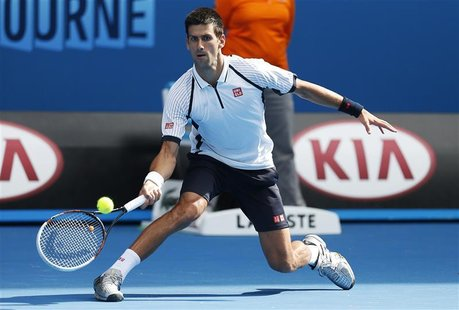 Novak Djokovic of Serbia hits a return to Radek Stepanek of Czech Republic during their men's singles match at the Australian Open tennis to