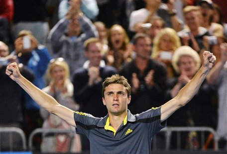 Gilles Simon of France celebrates defeating compatriot Gael Monfils in their men's singles match at the Australian Open tennis tournament in