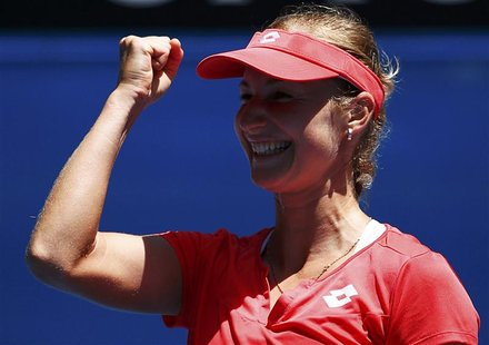 Ekaterina Makarova of Russia celebrates defeating Angelique Kerber of Germany in their women's singles match at the Australian Open tennis t