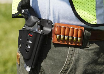"A handgun, holster and cartridges are seen on a participant at the ""Restore the Constitution Rally 4-19-2010"" at Gravelly Point Park, Virgin"