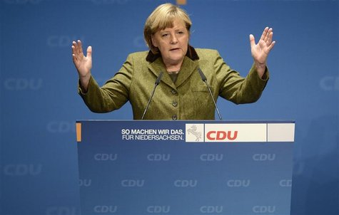 German Chancellor Angela Merkel delivers her speech during an election campaign with Lower Saxony's Christian Democratic state governor Davi