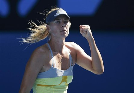 Maria Sharapova of Russia celebrates defeating Kirsten Flipkens of Belgium in their women's singles match at the Australian Open tennis tour