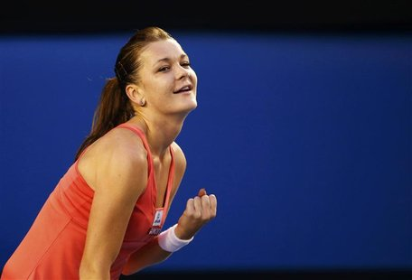 Agnieszka Radwanska of Poland celebrates defeating Ana Ivanovic of Serbia during their women's singles match at the Australian Open tennis t