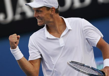 Tomas Berdych of Czech Republic celebrates defeating Kevin Anderson of South Africa in their men's singles match at the Australian Open tenn