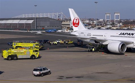 Fire trucks surround a Japan Airlines Boeing 787 Dreamliner that caught fire at Logan International Airport in Boston, Massachusetts January
